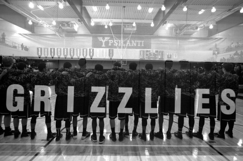 A double exposure during the National Anthem before Huron takes on Ypsilanti on Jan. 23, 2015. Patrick Record | The Ann Arbor News